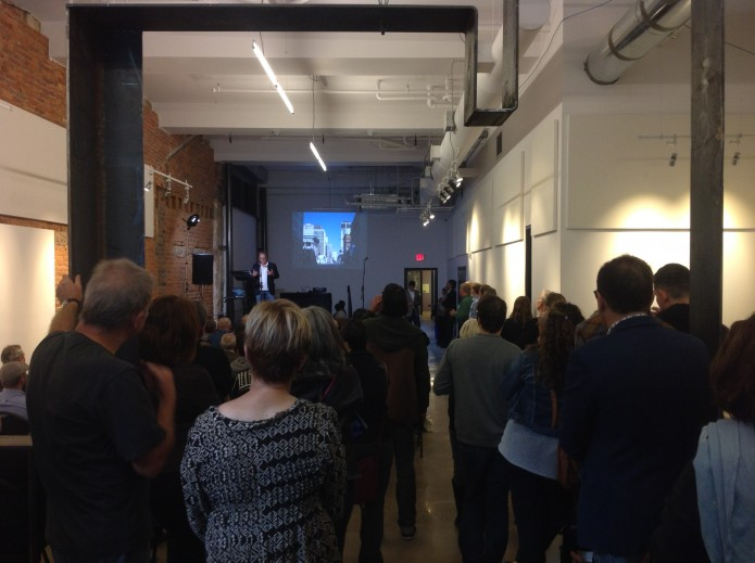 A standing-room-only crowd at the Arts Centre & Lofts listens to seven talks about the link between design and prosperity.